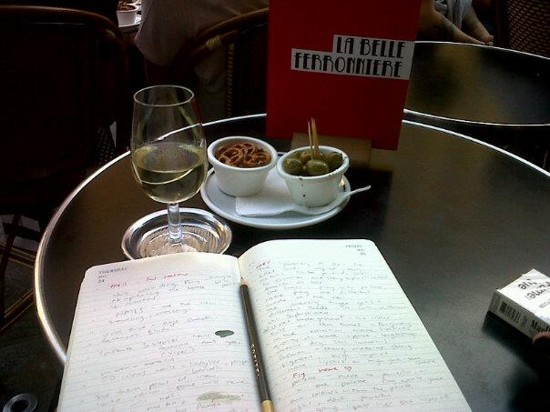 Journalling at a sidewalk cafe in Paris